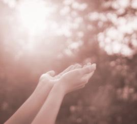 hands raised to outside light